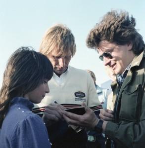 Derek Bell autographing a polaroid of himself just taken by mate Gordon. Confused? Derek was!