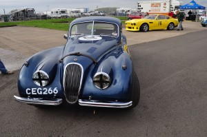"""XK120 Coupe awaiting pre-race scrutineering. """"Four wheels + driver …. on you go""""!"""