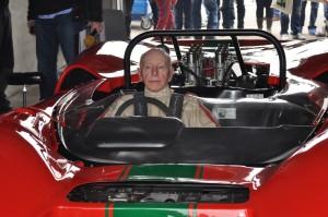 Lola being warmed up by motor racing legend John Surtees ahead of a demo lap