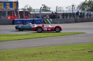 Cooper Maserati Monaco (20) and Maserati T61 Birdcage (61) locked in battle